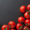 red tomatoes on blac - PhotoDune Item for Sale