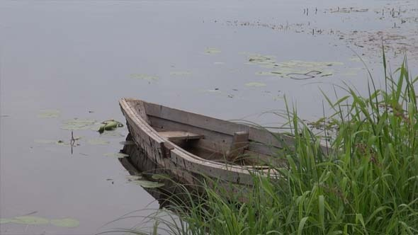 An Old Wooden Boat In The River