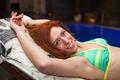 Happy woman in bikini relaxing - PhotoDune Item for Sale