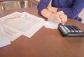 Unemployed and divorced woman with debts reviewing her monthly bills - PhotoDune Item for Sale