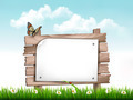 Nature background with green grass and flowers and wooden sign  - PhotoDune Item for Sale
