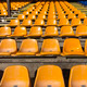 empty yellow seats at sports stadium - PhotoDune Item for Sale