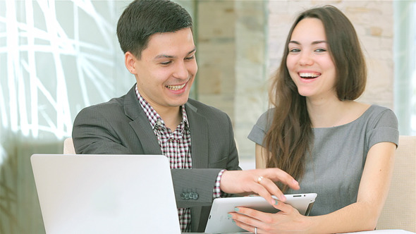 Confident Young People Work for the Tablet