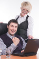 Attractive business man and lady are working on laptop in office - PhotoDune Item for Sale
