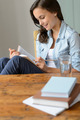 Teenage girl student reading book at home - PhotoDune Item for Sale