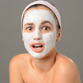 Surprised teenage girl looking camera face mask - PhotoDune Item for Sale