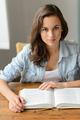 Student teenage girl reading book looking camera - PhotoDune Item for Sale