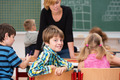 Young boy in class turning to smile at the camera - PhotoDune Item for Sale