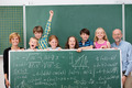 Young schoolchildren posing with a chalkboard - PhotoDune Item for Sale