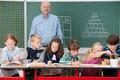 Group of schoolchildren working in the classroom - PhotoDune Item for Sale