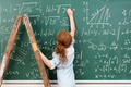 Little girl genius working on a maths equation - PhotoDune Item for Sale