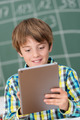 Young boy using a tablet in the schoolroom - PhotoDune Item for Sale