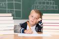 Dejected little boy in class in school - PhotoDune Item for Sale