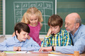Young schoolchildren in class with their teacher - PhotoDune Item for Sale