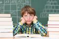 Grumpy little boy in class - PhotoDune Item for Sale