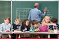 Happy young children in class at school - PhotoDune Item for Sale