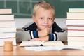 Overworked little boy in school - PhotoDune Item for Sale