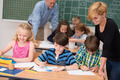 Two teachers in class with their young students - PhotoDune Item for Sale