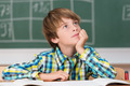 Young schoolboy daydreaming in class - PhotoDune Item for Sale