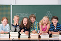 Laughing group of young school kids in class - PhotoDune Item for Sale