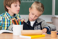 Two little boys working together in class - PhotoDune Item for Sale