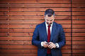 Businessman in a suit with smartphone - PhotoDune Item for Sale