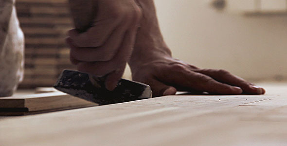 Carpenter Worker Installing Parquet