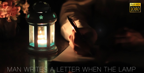 Man Writes A Letter When The Lamp