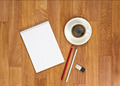 Blank notepad with office supplies and cup of coffee on wooden t - PhotoDune Item for Sale