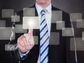 Businessman Pushing Button On Transparent Screen - PhotoDune Item for Sale