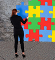 Businesswoman Solving Colorful Jigsaw Puzzle - PhotoDune Item for Sale