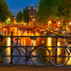 Night  illumination of Amsterdam canal and bridge - PhotoDune Item for Sale