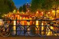Night  illumination of Amsterdam canal and bridge - PhotoDune Item for Sale