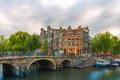 Dusk city view of Amsterdam canal and bridge - PhotoDune Item for Sale