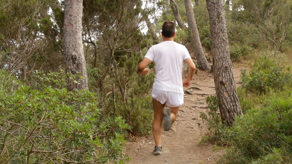 Runner Running Across the Fields