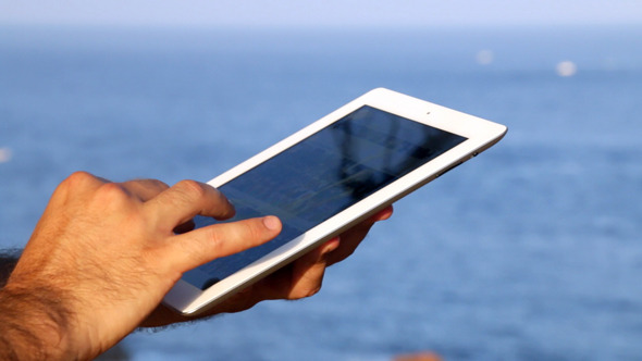 Browsing tablet Next to the Seashore Panoramic