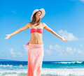 Happy woman at the beach - PhotoDune Item for Sale