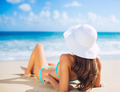 Woman relaxing on the beach - PhotoDune Item for Sale