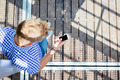Young blond man touching the screen of his smartphone - PhotoDune Item for Sale