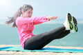 woman doing workout in the beach - PhotoDune Item for Sale