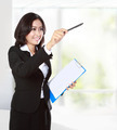 businesswoman pointing to copyspace - PhotoDune Item for Sale