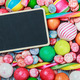 blackboard for the text on the background of lollipops and sweet - PhotoDune Item for Sale