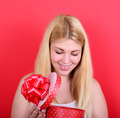 Portrait of happy woman opening gift box against red background - PhotoDune Item for Sale