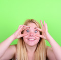 Portrait of girl with funny face against green background - PhotoDune Item for Sale