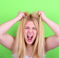 Portrait of desperate blond young woman pulling hair against gre - PhotoDune Item for Sale