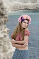 Young beautiful woman in a wreath enjoys sunny day - PhotoDune Item for Sale