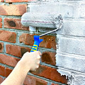 Paint roller through a brick wall - PhotoDune Item for Sale