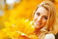 Woman holding autumn leaves - PhotoDune Item for Sale