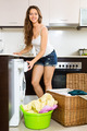 Happy girl washing clothes in washer - PhotoDune Item for Sale