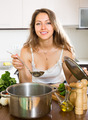 Woman cooking soup in kitchen - PhotoDune Item for Sale